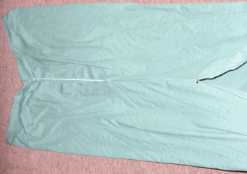 Bedsheet garment on floor