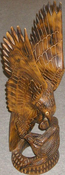 Wood carving of eagle and snake