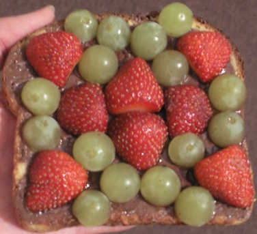 Toast, chocolate spread, grapes, strawberries